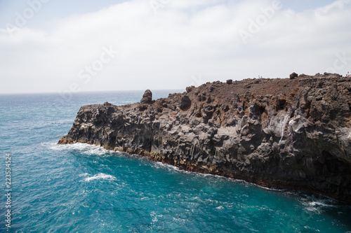 Rocky area formed by lava called Los Hervideros in Lanzarote, Canary Islands, Spain.