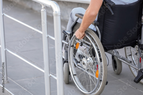 Foto  Young man in wheelchair on ramp outdoors