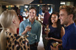 canvas print picture - Group Of Young Friends Relaxing In Bar Together On Night Out