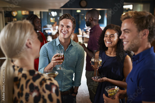 Group Of Young Friends Relaxing In Bar Together On Night Out - 223539376