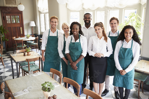 Fotografie, Obraz  Portrait Of Restaurant Team Standing In Empty Dining Room