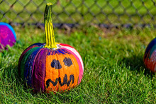 Painted Pumpkins Outside. School Craft. Preparation For Halloween. Blurred Background. Copy Space For Your Text