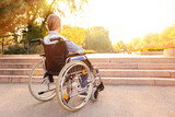 Fototapeta Fototapety na drzwi - Girl in wheelchair near stairs outdoors