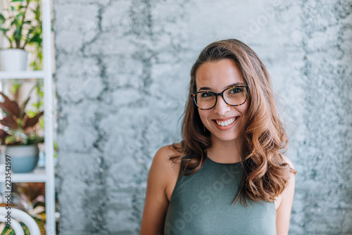 Headshot of gorgeous young woman with eyeglasses.