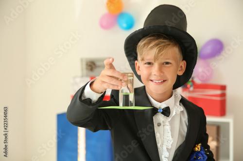 Cute little magician showing trick indoors Tapéta, Fotótapéta