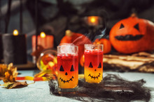 Creative Glasses With Jelly Dessert Prepared For Halloween Party On Table
