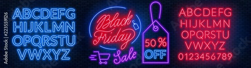 Photographie  Black Friday neon lettering on brick wall background with the alphabet