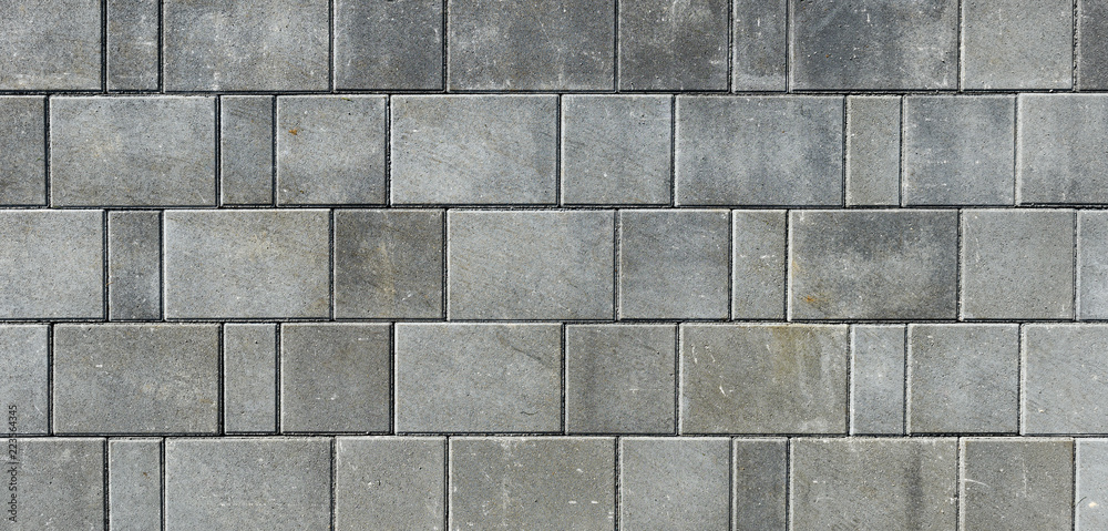 Fototapeta Concrete or cobble gray pavement slabs or stones  for floor, wall or path.