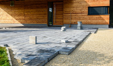 Laying Gray Concrete Paving Sl...