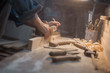 Leinwanddruck Bild - Handmade concept. Women's hands do the product of wood. Wood workshop with a tool and a lamp