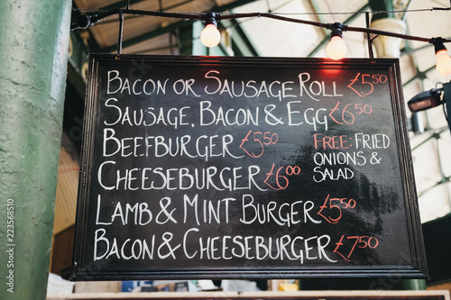 Canvas Print Close up of a menu board with prices at a market stall in Borough Market, London, UK