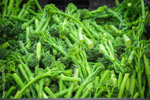 Fresh broccolini on display at Broadway Market, a street market in Hackney, East London