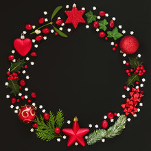 Abstract Christmas Wreath Garland With Winter Flora And Bauble Decorations On Black Background. Top View.