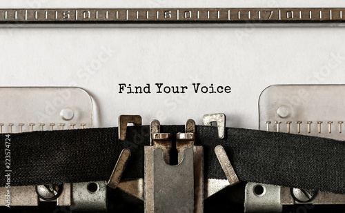 Photo Text Find Your Voice typed on retro typewriter