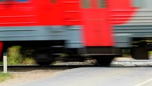 Passenger Train Passes Crossing The Road. Travelling By Fast Trains Is A Fascinating Way To See The World Around.