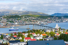 View Of Tromso On Island Of Tromsoya Linked Across Tromsoysundet Strait With Tromsdalen On Mainland By Tromso Bridge. Norway