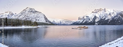 Poster Bergen Wide Panoramic Sunset Landscape and Distant Snowcapped Rocky Mountains at Lake Minnewanka in Banff National Park, Alberta, Canada