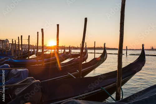 Spoed Foto op Canvas Gondolas Sunrise over the Gondola parking in Venice, Italy