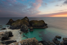 The Beach And Cliffs Of Kynance Cove In Cornwall, UK Which Is A Popular Tourist Destination At Sunset In A Picturesque Landscape Image