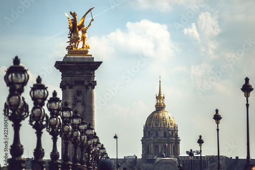 Deurstickers Historisch mon. Alexandre III Bridge and Hotel Des Invalides against sky in city