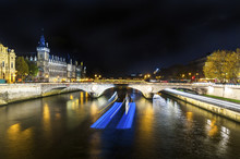 Light Trails On Seine River Against Sky In City At Night