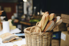 Close-up Of Fresh Bread Loaves In Wicker Basket For Sale At Store