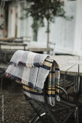 Close-up of fabric on chair by table in greenhouse
