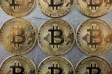 Overhead View Of Bitcoins Arra...