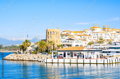 View of Puerto Banus marina with boats and white houses in Marbella town, Andalu Wallpaper Mural
