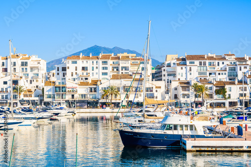 View of Puerto Banus marina with boats and white houses in Marbella town, Andalusia, Spain