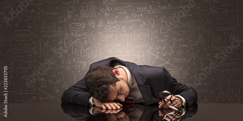Fotografía  Elegant teacher fell asleep at his workplace with full draw blackboard concept