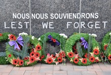 Wreaths Laid In Front Of Lest ...