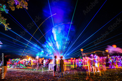 Stampa su Tela Outdoor night music party with laser lights and fire