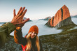 canvas print picture - Couple friends giving five hands traveling outdoor hiking in Norway mountains adventure lifestyle positive emotions concept family together on journey vacations
