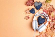 White Headphones With Denim Heart, Autumn Maple Leaves And Copy Space. Top View, Flat Lay.