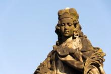Statue Of Saint Vitus From Ferdinand Maxmilian Brokoff 1714 On Charles Bridge Near Mala Strana Bridge Tower, Prague, Czech Republic, Sunny Day, Clear Blue Sky Background