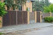 Brown Fence And A Wooden Gate And A Door On The Street Near The Road