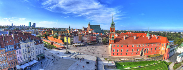 Beautiful colorful HDR aerial image of the famous Old town in Warsaw, Poland. The Royal Castle and Sigismund's Column called Kolumna Zygmunta on blue dramatic sky - panoramic image