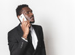 Close up portrait of afro american man looking at his mobile phone. business negotiations by phone