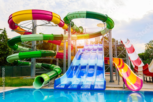 Foto  Water park, slides near the pool, summer holidays