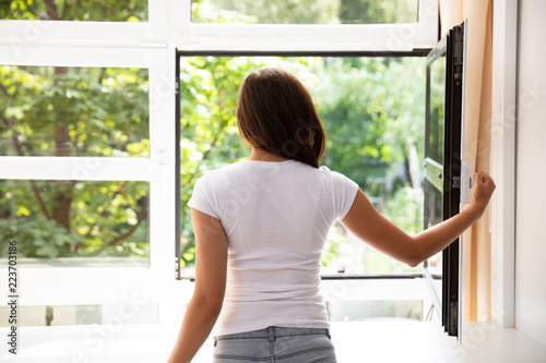 Fotografie, Obraz  Woman Looking Through Window