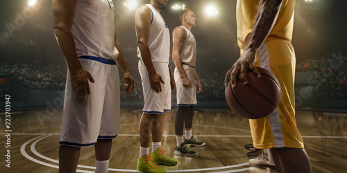 Basketball players on big professional arena before the game Canvas Print