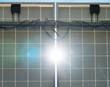 Behind the solar panels. Renewable energy.