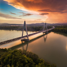 Budapest, Hungary - Megyeri Bridge Over River Danube At Sunset With Beautiful Dramatic Clouds And Sky
