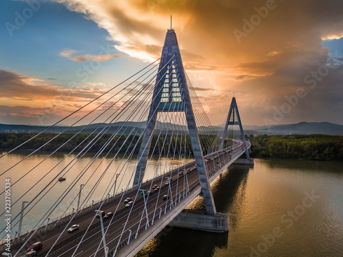 obraz PCV Budapest, Hungary - Megyeri Bridge over River Danube at sunset with heavy traffic and beautiful blue and orange sky