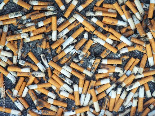 Fotografija  Ashtray, cigarette butts background