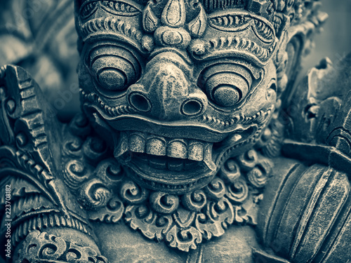 Traditional stone statues depicting demons in Bali,Indonesia Fototapet