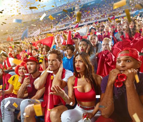 Fotografía  Young sport supporter sad fans at stadium