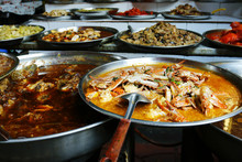 Crab Curry And Assortment Of Asian Dishes