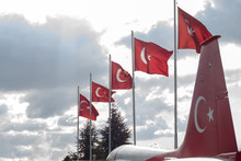 Line Of Turkish Flag With Cropped View Of A Tailplane